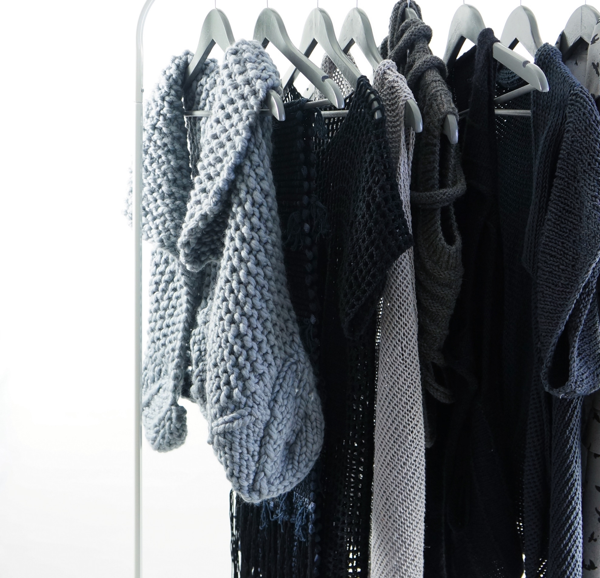 A rack of garments designed by Manual For The Invisible.